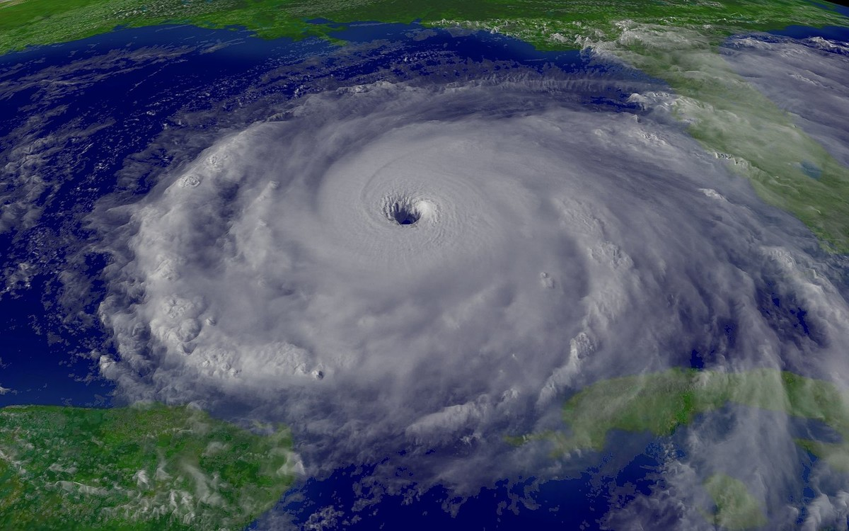 A hurricane is a weather system in which a low pressure center attracts the air around it, creating the cyclonic shape.