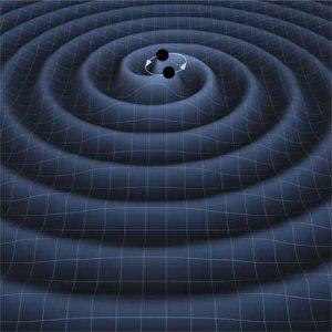 A binary black hole system emitting graviational waves, Credit: T. Carnahan NASA GSFC